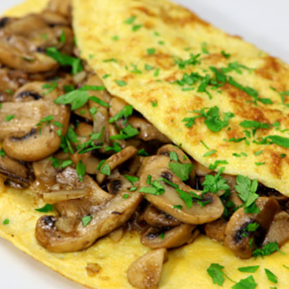 Omelette with onions, mushrooms and chives